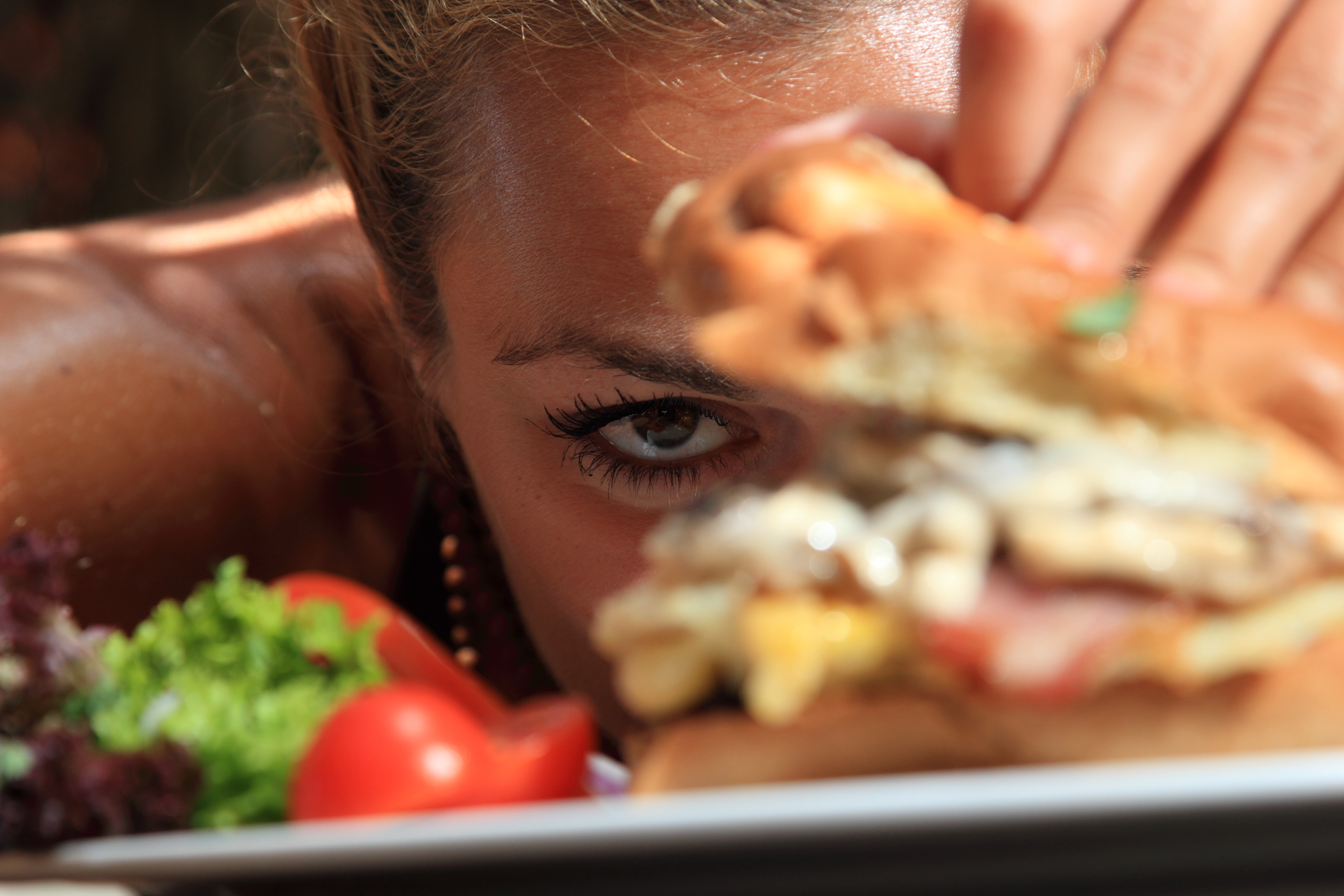 Woman eating a yummy cheeseburger